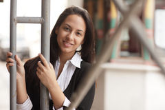 Woman posing in an urban setting Stock Images