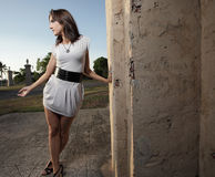 Woman posing by a wall Royalty Free Stock Photos
