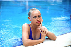 Woman posing in the water of swimming pool. Royalty Free Stock Photography
