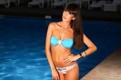 Woman posing wearing a swimsuit Stock Photos