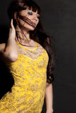 Woman posing wearing yellow dress Stock Images