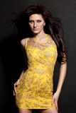 Woman posing wearing yellow dress Royalty Free Stock Photo