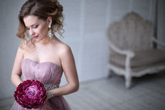 Woman posing in a wedding dress. Royalty Free Stock Image