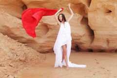 Woman posing wit red fabric outdoor Royalty Free Stock Images