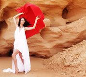 Woman posing wit red fabric outdoor Royalty Free Stock Photos