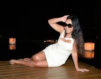 Woman posing on wooden floor Stock Image