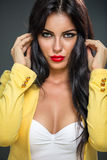 Woman posing in yellow blazer Royalty Free Stock Photos