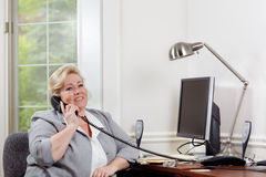 Woman positive phone conversation stock photo