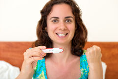 Woman with positive pregnancy test Royalty Free Stock Photo