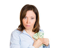 Woman possessive about her money Stock Photo