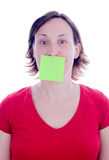 Woman post-it on her mouth Royalty Free Stock Photos