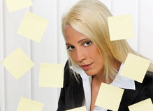 Woman with post-its many tasks. Stressed young woman with multiple tasks Saved slips Stock Photos