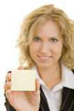 Woman with post it note. Portrait of young businesswoman with blank post it or sticky note, white background Stock Photos