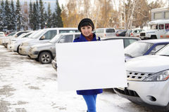 Woman with the poster. Happy woman with the poster in hands on the street Stock Photography