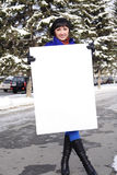 Woman with the poster. Happy woman with the poster in hands on the street Stock Photos