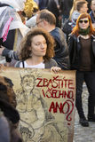 Woman with poster against the president Zeman attending the demonstration on Prague Wenceslas square 2017 Stock Photos