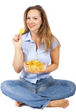 Woman with potato chips. Blond woman with potato chips royalty free stock photos
