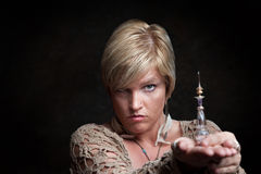 Woman With Potion Bottle Stock Image