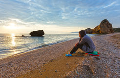 Woman on Potistika beach. Sunrise view (Greece) Royalty Free Stock Image