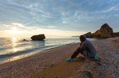 Woman on Potistika beach. Sunrise view (Greece) Royalty Free Stock Photography