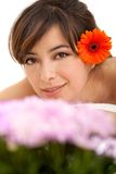 Woman potrait with a flower Royalty Free Stock Image