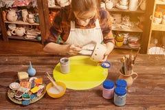 Woman potter paint Stock Photo