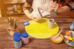Woman potter paint Royalty Free Stock Image