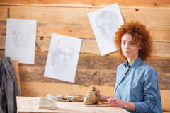 Woman potter working with clay in workshop Royalty Free Stock Photos