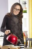 Woman pour the tea Stock Photo