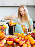 Woman pouring beverages with fruits Royalty Free Stock Photography