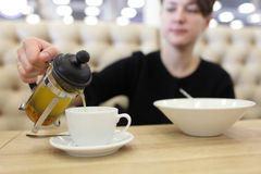 Woman pouring buckthorn tea Stock Images