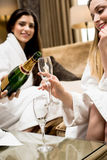Woman pouring champagne on glass. stock photos
