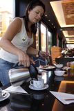 Woman pouring coffee Stock Images