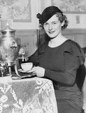 Woman pouring coffee from a coffee urn Stock Image