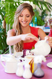Woman pouring cup of tea Stock Image