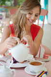Woman pouring the cup of tea Stock Images