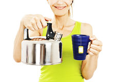 Woman Pouring Cup Of Tea Stock Photography