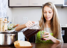 Woman pouring fresh kvass in glass Royalty Free Stock Photography