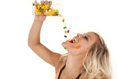 Woman pouring jelly beans mouth Royalty Free Stock Photos