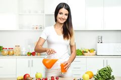 Free Woman Pouring Juice In Glass Royalty Free Stock Photos - 99708718