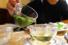 Woman pouring mint tea Royalty Free Stock Photo