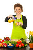 Woman pouring orange juice Royalty Free Stock Images