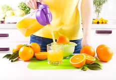 Woman pouring orange juice into glass Royalty Free Stock Photography