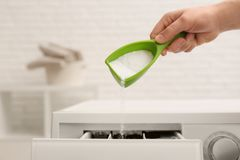 Free Woman Pouring Powder Into Drawer Of Washing Machine, Closeup. Laundry Day Stock Photo - 144537550