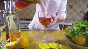 Woman pouring sangria into a glass slow motion stock footage