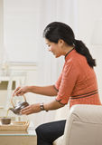 Woman Pouring Tea Royalty Free Stock Photo