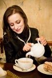 Woman pouring a tea Stock Photo