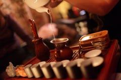 Woman pouring tea from teapot Royalty Free Stock Photos