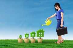 Woman pouring water at the tree house Royalty Free Stock Images