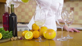 Woman pouring white wine in a glass slow motion stock video footage